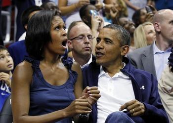 4240879003_President_Barack_Obama_Michelle_Obama_Kiss_Cam_Cover_answer_1_xlarge
