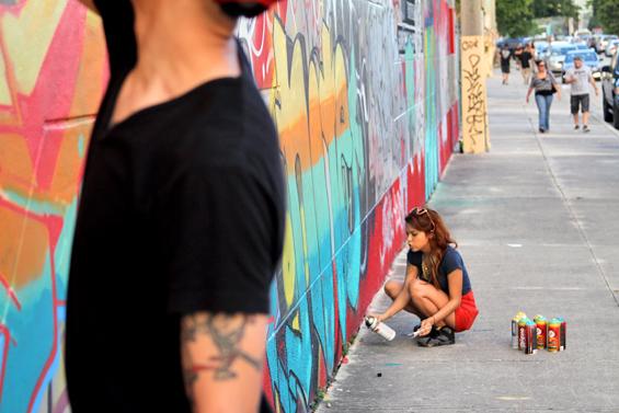 WomenMaking Graffiti