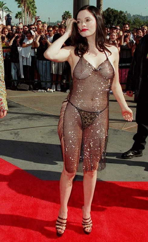 We can't help but be reminded of Rose McGowan's infamous barely there