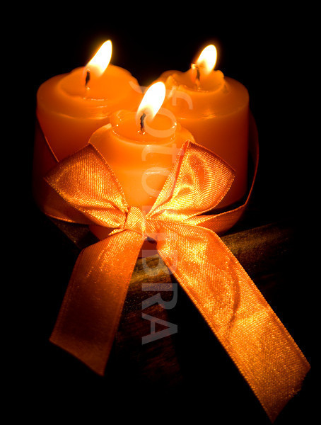 Three orange candles