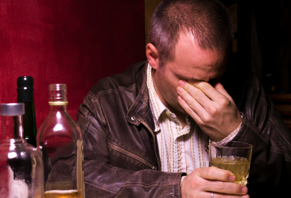 Digital capture of forty year old man drinking alone portrait.