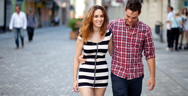 Candid image of a young couple walking in the old part of town